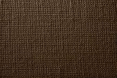 Fabric With Crisscross Fibers Of Brown Color
