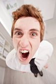 Angry Clerk In Wide Angle Shouting