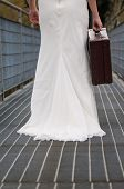 Bride Walking On The Bridge With Her Suitcase