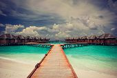 The Maldives , a house on the water is a beautiful turquoise sea
