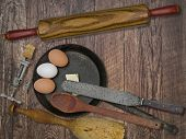 faded colors of a vintage utensils set, skillet, eggs,butter, space for your text