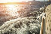 Yacht, sea overboard, sailing regatta during sunset.