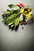 Herbs and spices on slate background - cooking, healthy or vegetarian food concept