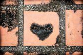 Black Heart On Concrete Floor Background