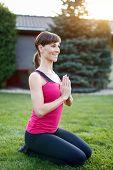 Woman Doing Yoga Exercise In Praying Pose