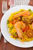 Paella On White Plate And Water