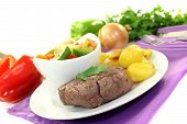 Roasted Ostrich Steaks With Baked Potatoes