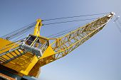 stock photo of dredge  - tower crane in the construction site ready for dredging - JPG