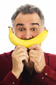 Man Hold Banana To Face, Imitating Smile