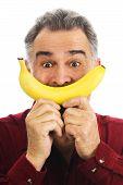Man Hold Banana To Face, Imitating Smile