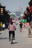 woman on bicycle in old town of Pingyao