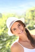 Portrait of beautiful woman with hat in park
