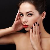 Sexy Makeup Woman With Red Lips And Black Finger Nails Posing