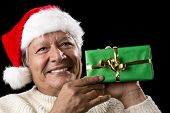 Elderly Man With Santa Cap And Green Wrapped Gift