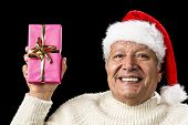 Merry Old Man Showcasing A Pink Wrapped Present