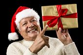 Avid Aged Man Pointing At Golden Wrapped Present