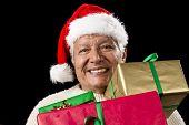 Jolly Old Man With Santa Cap And Three Xmas Gifts