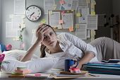 Businesswoman Waking Up On Office Desk