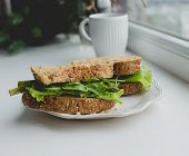 Food. Delicious sandwich on the windowsill