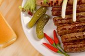 picture of scallion  - Grilled sausages with red hot chilli peppers - JPG