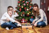 Happy Mother And Two Her Sons. Christmas Photo