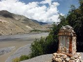 Chorten Near River Delta And Himalayas