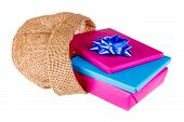 Wrapped Gifts Iin A Jute Bag Isolated On White