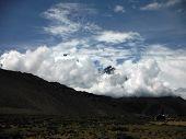 Heavy Monsoon Clouds Before Himalayan Peaks