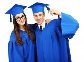 Graduate students wearing graduation hat and gown, isolated on white