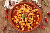 pic of stew  - an earthenware bowl with potaje de garbanzos con jamon - JPG
