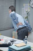 Tired Business With Back Pain