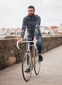 Hipster Man Riding a Bike