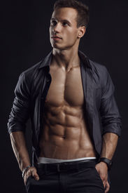 pic of packing  - Strong Athletic Man Fitness Model Torso showing six pack abs - JPG