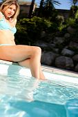 Woman Pool Legs In Water