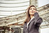 picture of skyscrapers  - Business woman talking at phone  - JPG