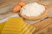 stock photo of lasagna  - Lasagna sheets with their main ingredients on a rustic table - JPG