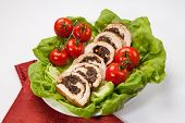 image of butter-lettuce  - Delicious turkey breast roulade cut in slices stuffed with prunes and almond - JPG