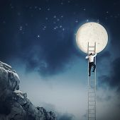 foto of reach the stars  - Man scale the sky because wants moon - JPG