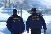 Criminal Police Patrolling In Winter - Walking Away