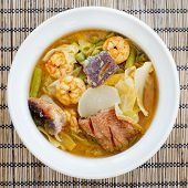foto of thai food  - hot and sour curry with tamarind sauce shrimp and snakehead and vegetables  - JPG
