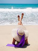 picture of beach hat  - Beautiful woman on the beach with straw hat on the beach in Bali Indonesia - JPG