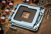 stock photo of processor socket  - Empty CPU processor socket with pins on motherboard - JPG