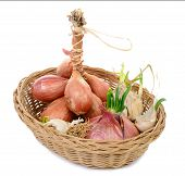 image of red shallot  - shallots and onions in a basket on the white background  - JPG