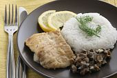 fried plaice with rice and mushrooms