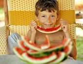 picture of crust  - cute young little boy with watermelon crustes smiling - JPG