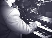 picture of organist  - musician playing hammond organ - JPG