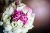 picture of marriage decoration  - Wedding Rings Close up with Cute Flower ranunculus bouquet - JPG