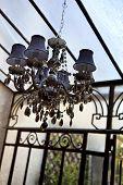 stock photo of chandelier  - Chandelier and pendants in an old veranda - JPG