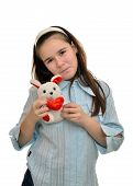 image of hare  - Teen girl holds favorite toy hare schoolgirl - JPG