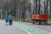 image of trailer park  - Happy family walking in the park near red trailer - JPG